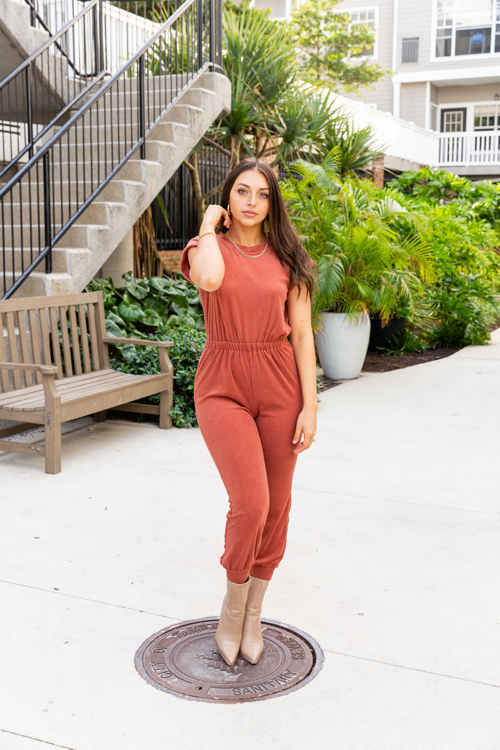 Short sleeves attach to a u-neckline on an oversized and relaxed bodice silhouette before meeting an elastic waistband going down into side pockets and skinny pant legs with a banded ankle cuff.