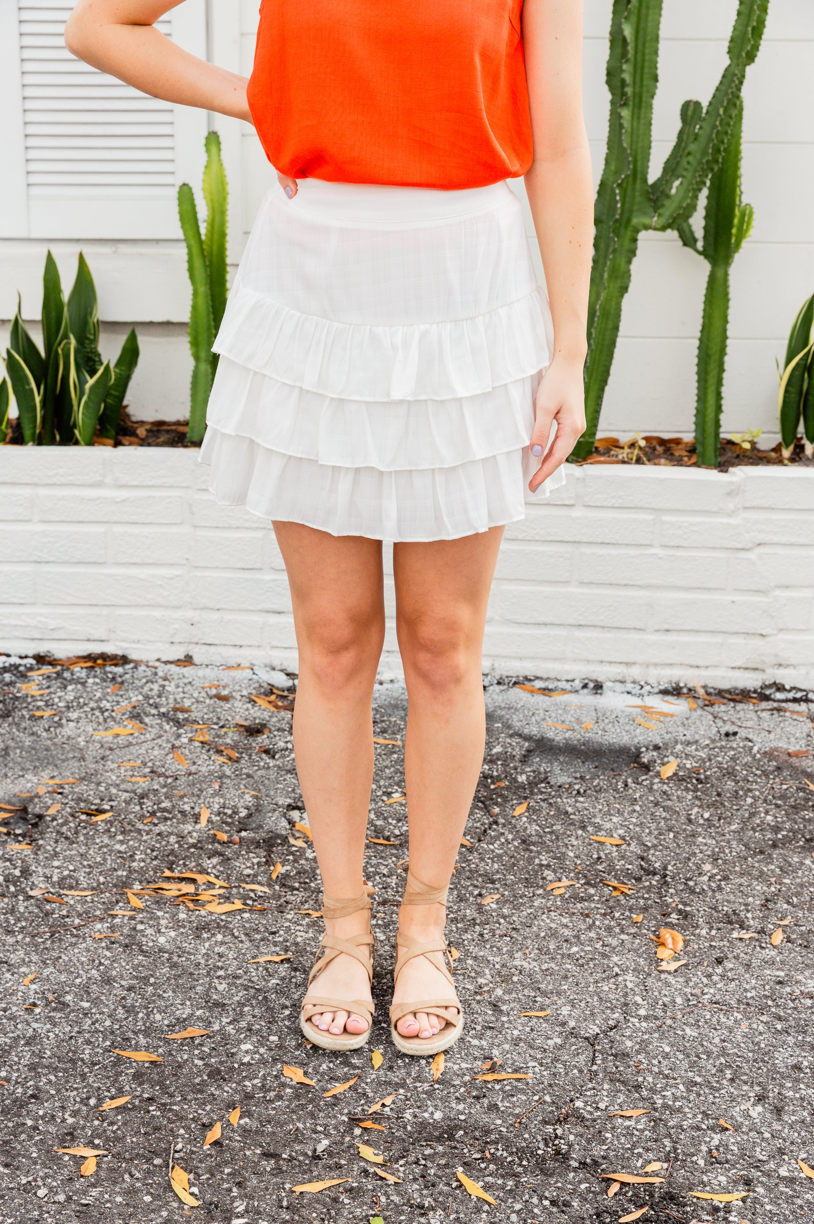 This breezy mini skirt has an elastic waistband that goes down into a layered ruffle skirt. Style this spring white skirt with a bodysuit.