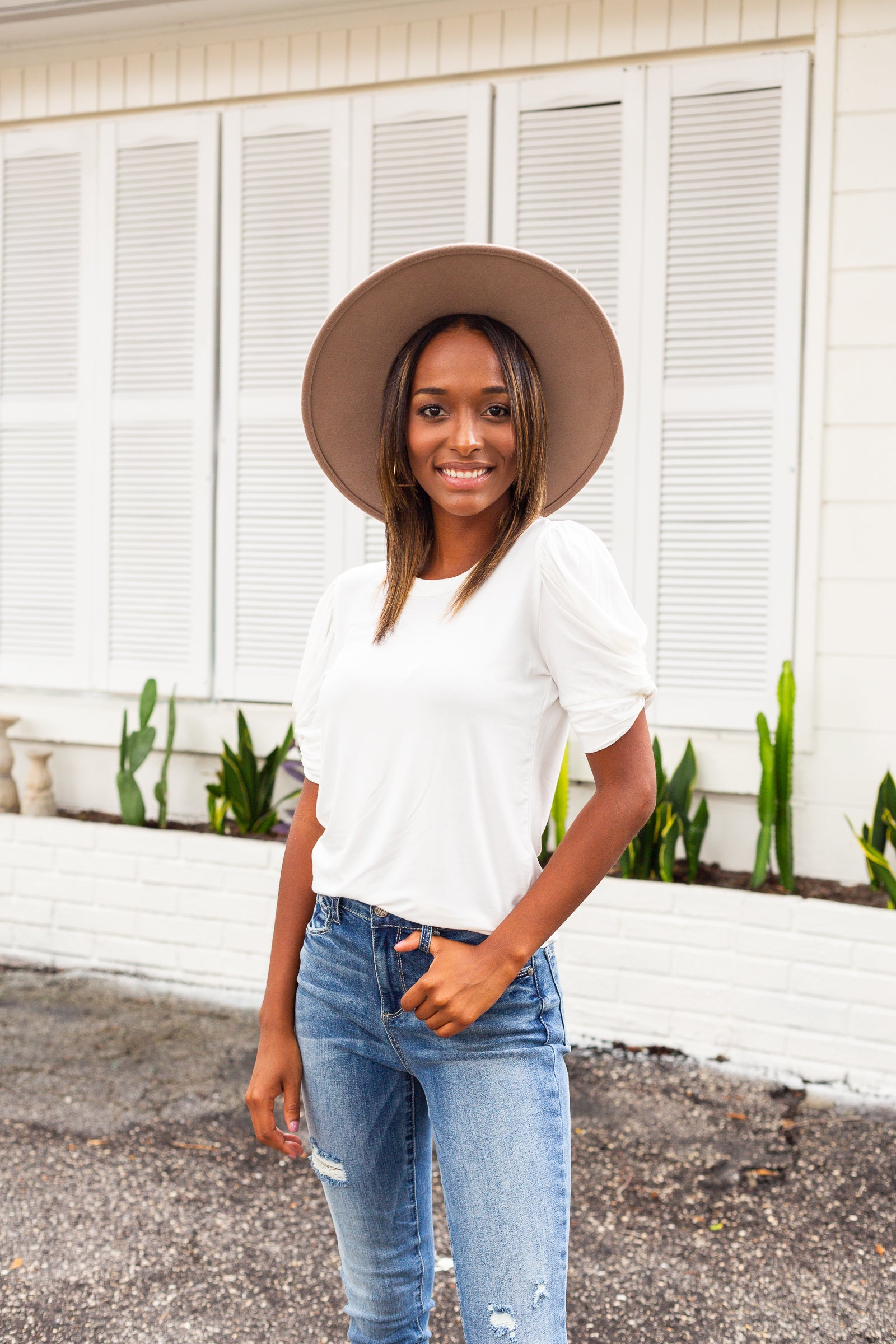 Short sleeves with a twisted detail attach to a u-neckline on a relaxed fit and loose bodice silhouette. Style this classic top with your favorite jeans.