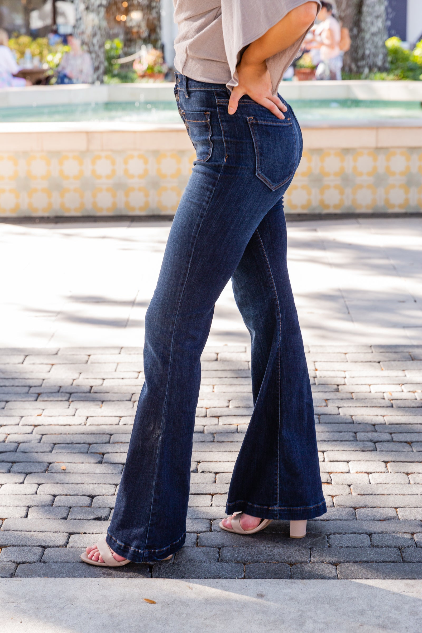 These denim pants have a fitted high-waisted waistband with a metal button-down fly that hugs your waist as they lead down to two front-facing pockets and bell-bottom and flared leg.