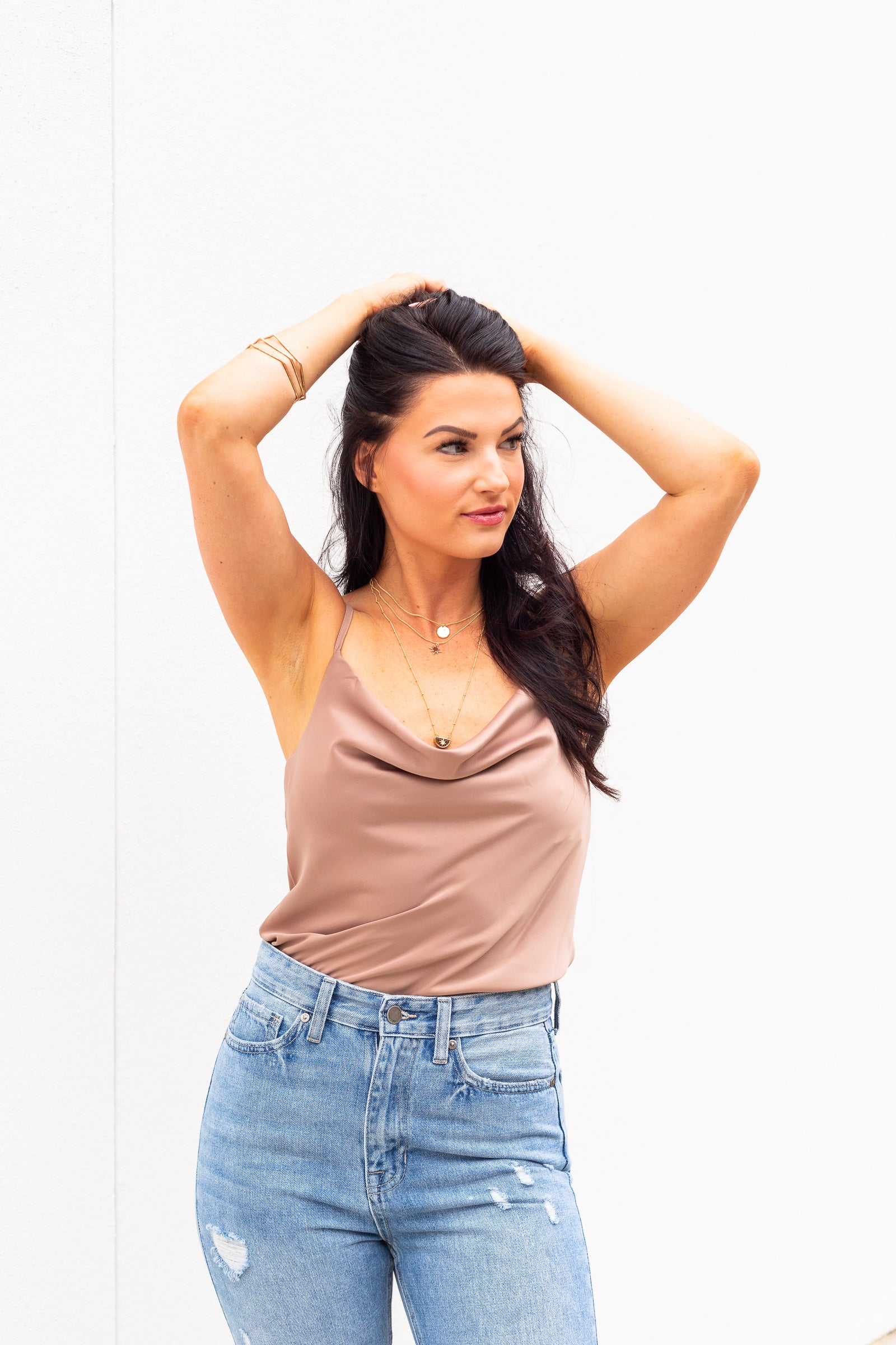This lightweight tank top has a cowl neckline that drapes your chest, skinny adjustable straps, and flows into a relaxed bodice.