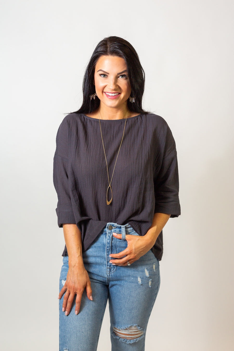 Mid-length sleeves attach to a wide u-neckline on an oversized and loose bodice silhouette. Style this lightweight autumn top with printed pants, pointed flats, a pendant necklace.