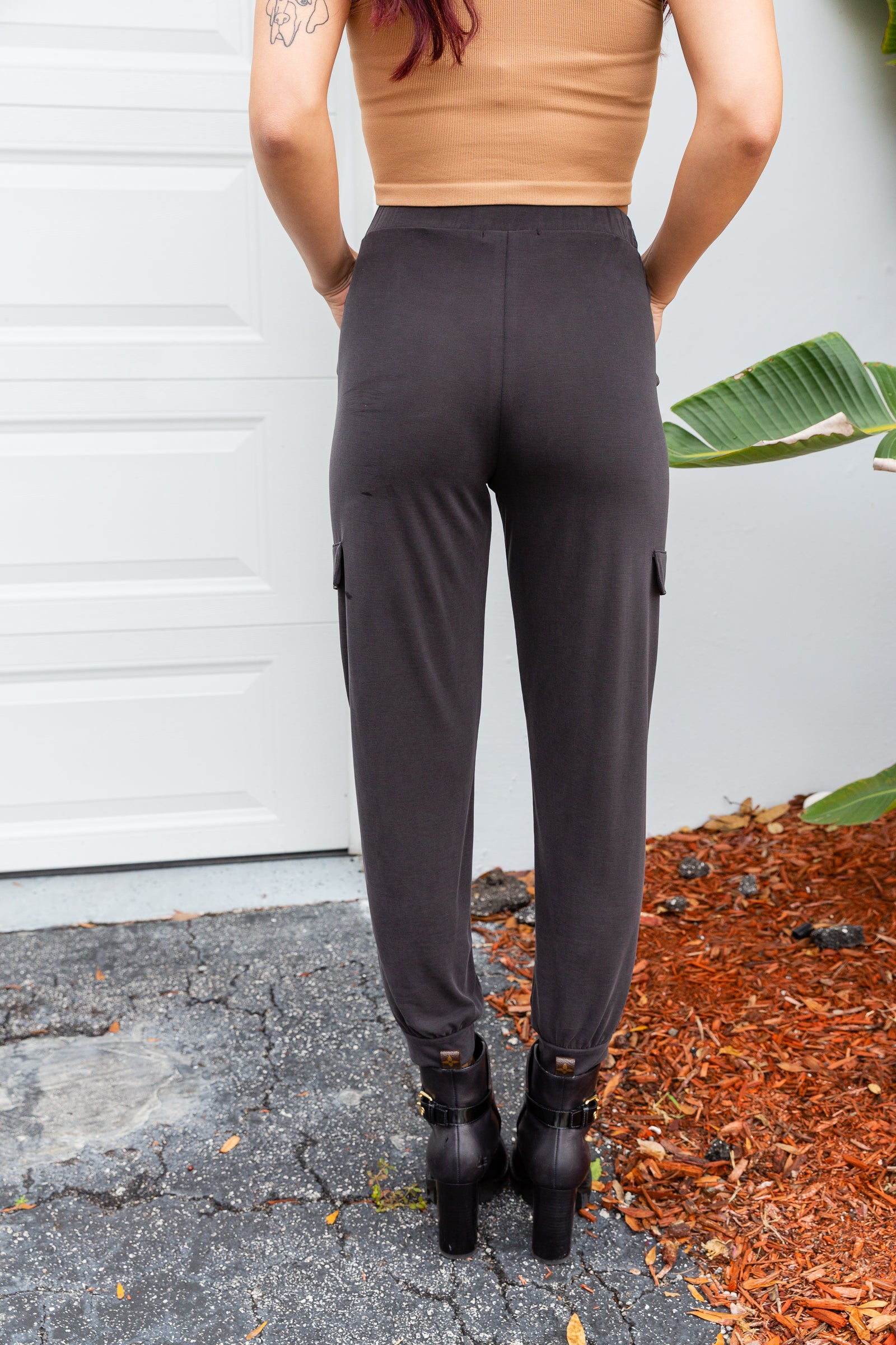These comfy joggers have a faux drawstring tie at the elastic waistband leading to comfortable fit pants with side pockets that tapers into a skinny pant leg with an elastic cuff at the ankle.