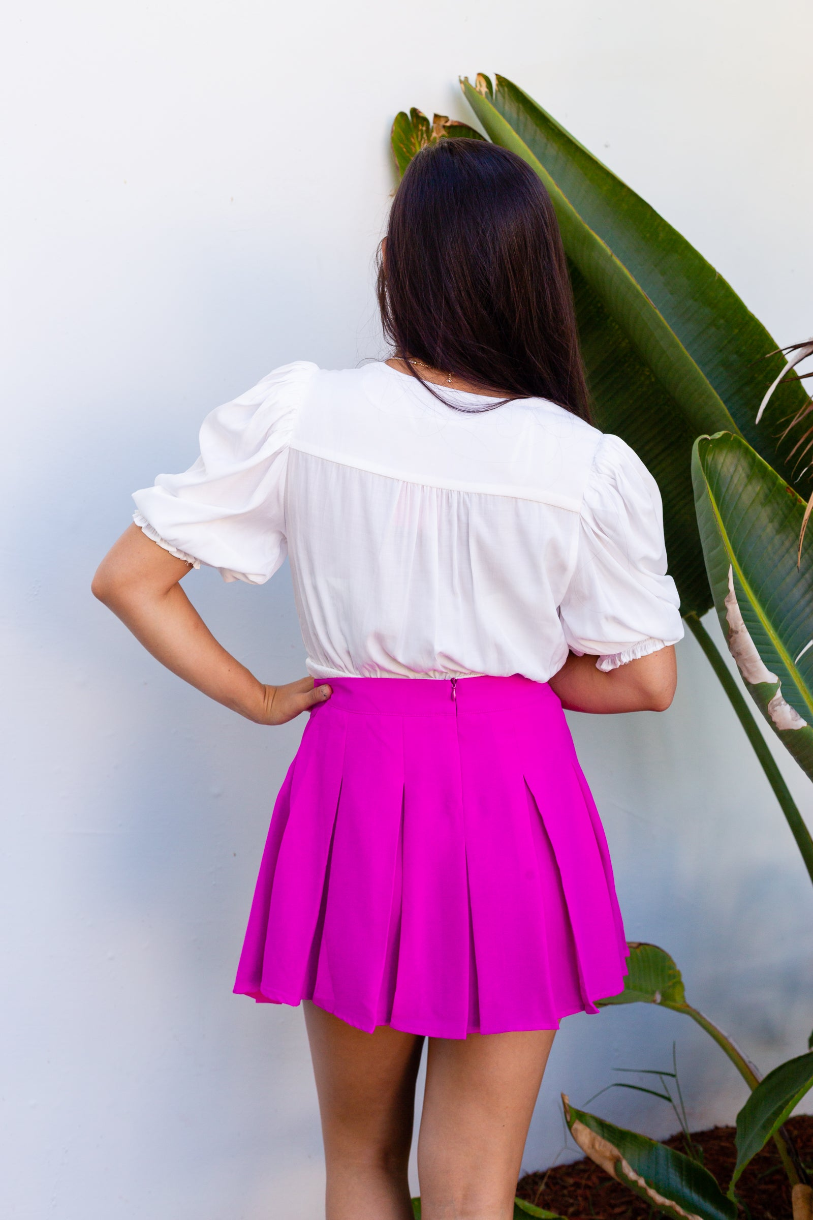 This bright and bold mini skirt has a fitted waistband and goes down into deep pleats before meeting short and flirty mini skirt hem.