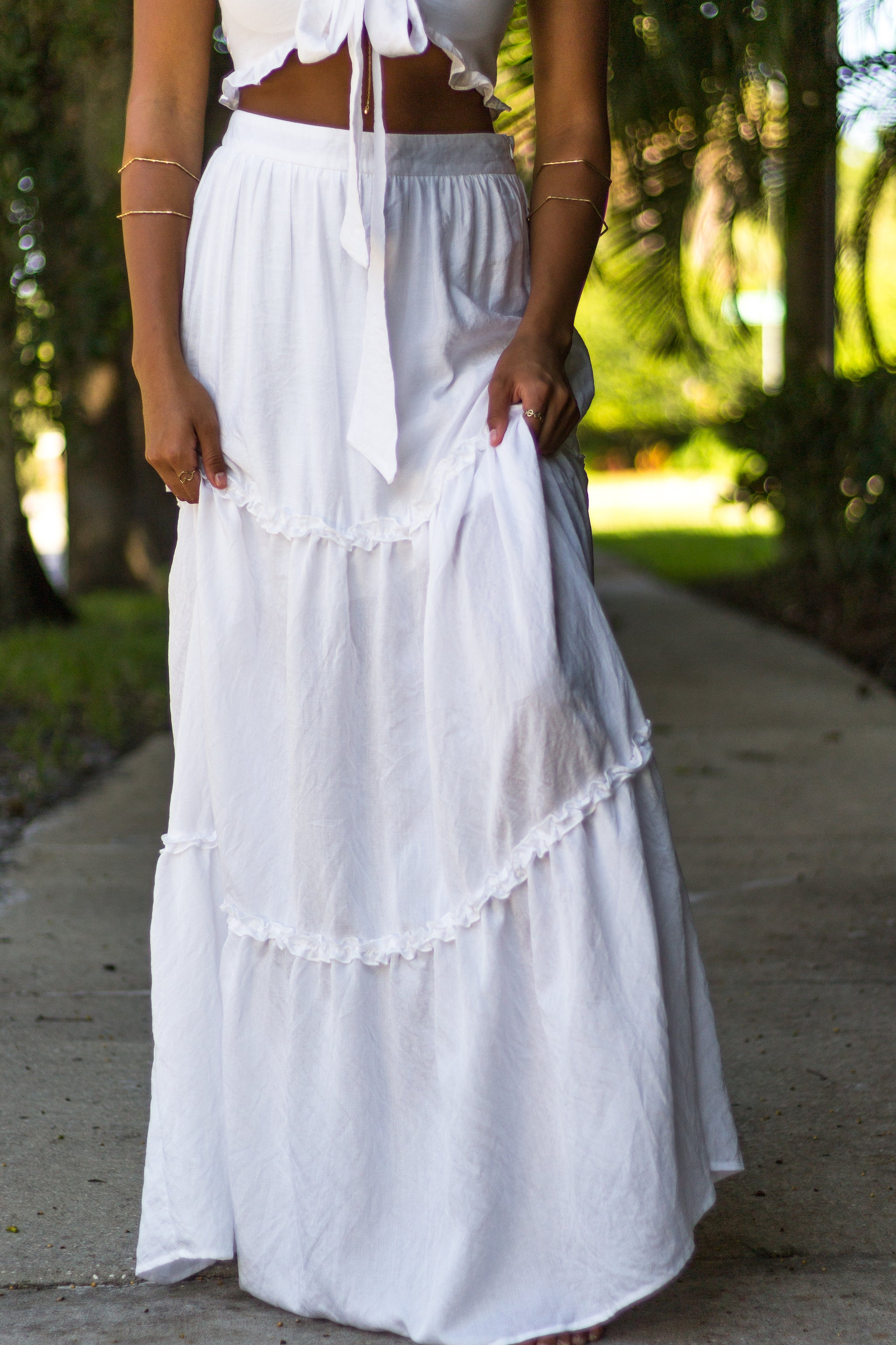 This stunning maxi dress has a fitted waistband then flows down into a tiered maxi skirt with ruffle details. Lightweight maxi skirt features a zipper with a hook and eye closure.