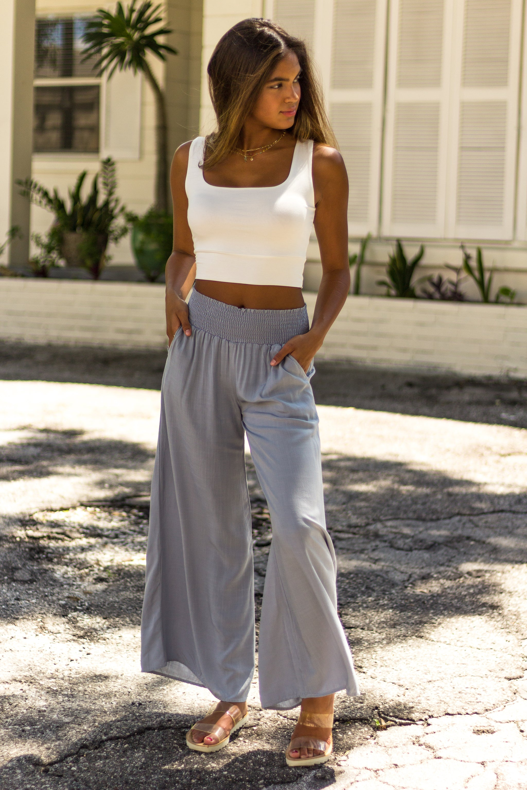 These lightweight pants have a smocked high-rise waistband and lead down to pockets on flowy and oversized pant legs. Style these breezy pants with a crop top.