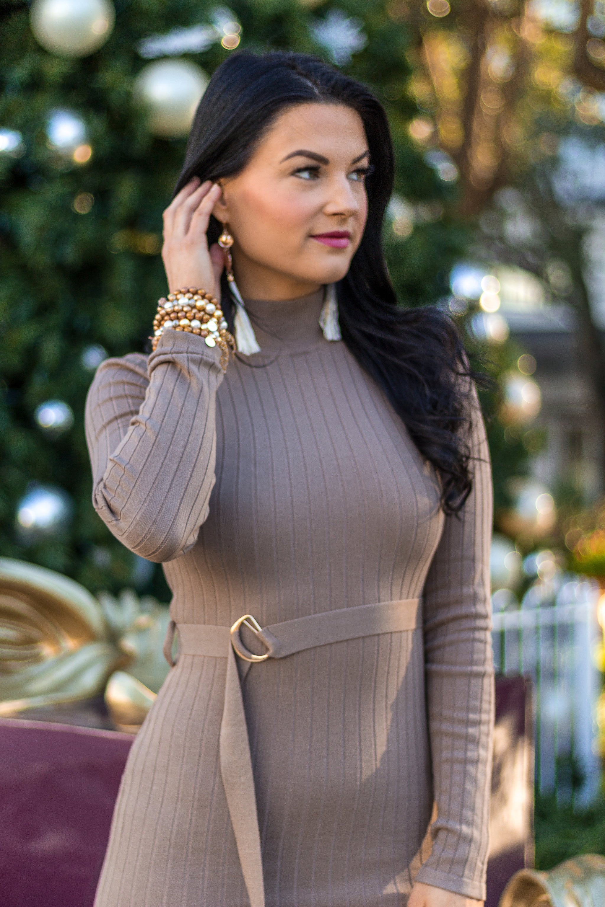 Long fitted sleeves attach to a banded high turtle neckline and leads to a fitted knit bodice and skirt silhouette that hugs your curves and hits below the knees at the calf.