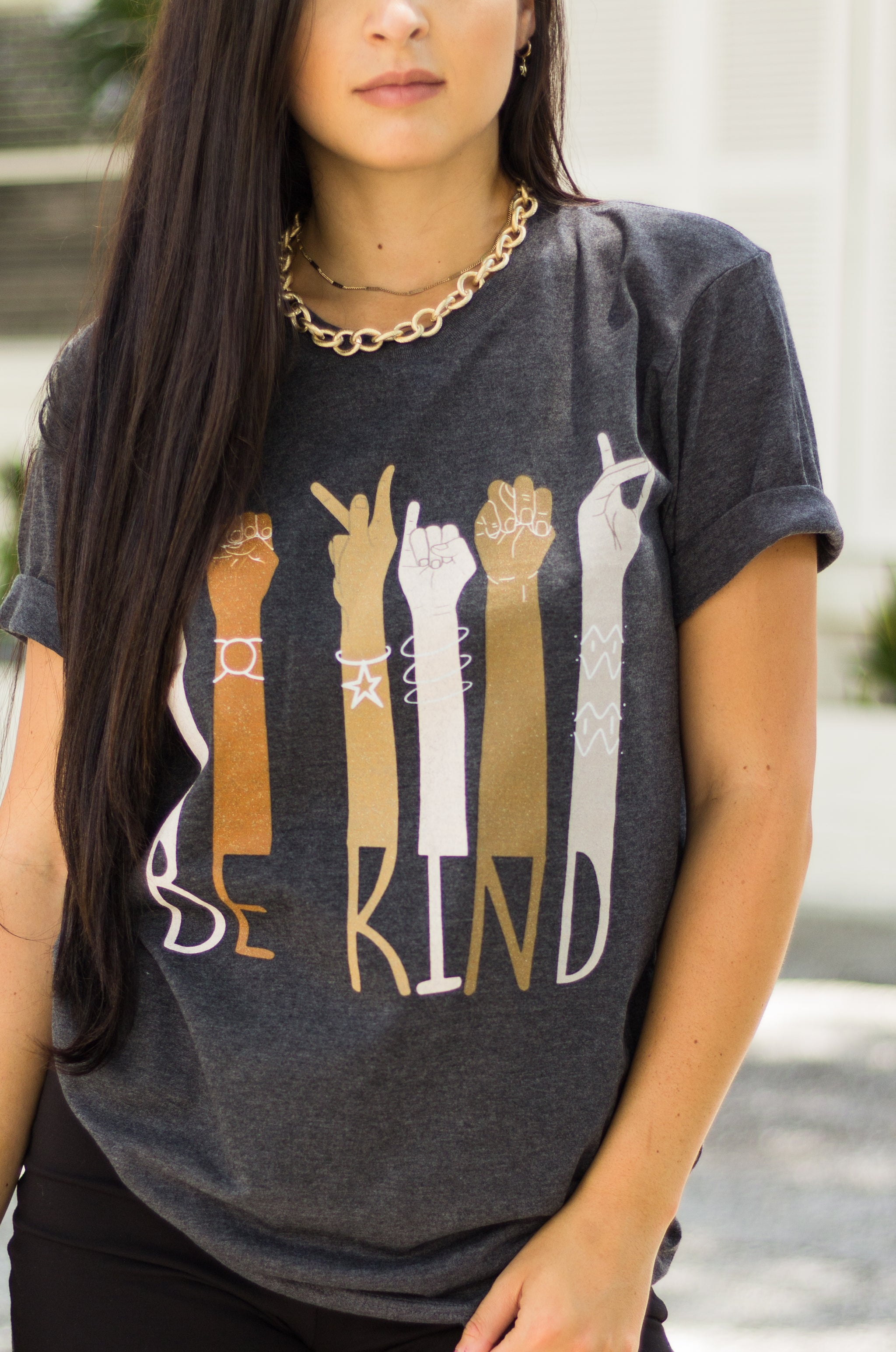 "It has a collection of arms up with hands signing ""Be Kind"" in ASL with the text below each arm. Style this classic graphic tee with a variety of bottoms!"