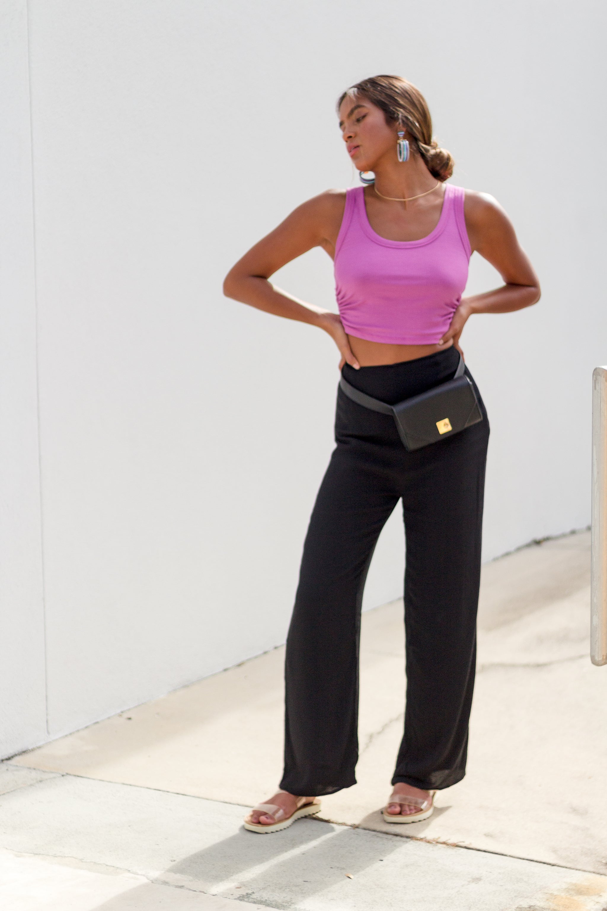 These high-rise pants have a fitted waistband that goes down into a darted and fitted waist then go down into relaxed and straight pant legs.