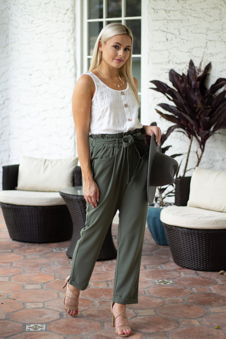 This comfortable pant has a high paperbag waistband that leads to belt loops and goes down to side pockets and relaxed fit pant legs with a cuffed hem at the ankles.