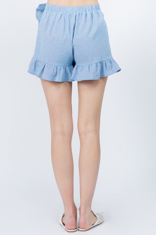 It has an elastic waistband with a ruffle-trimmed skirt panel that sits atop of relaxed shorts with a ruffle bottom hem.