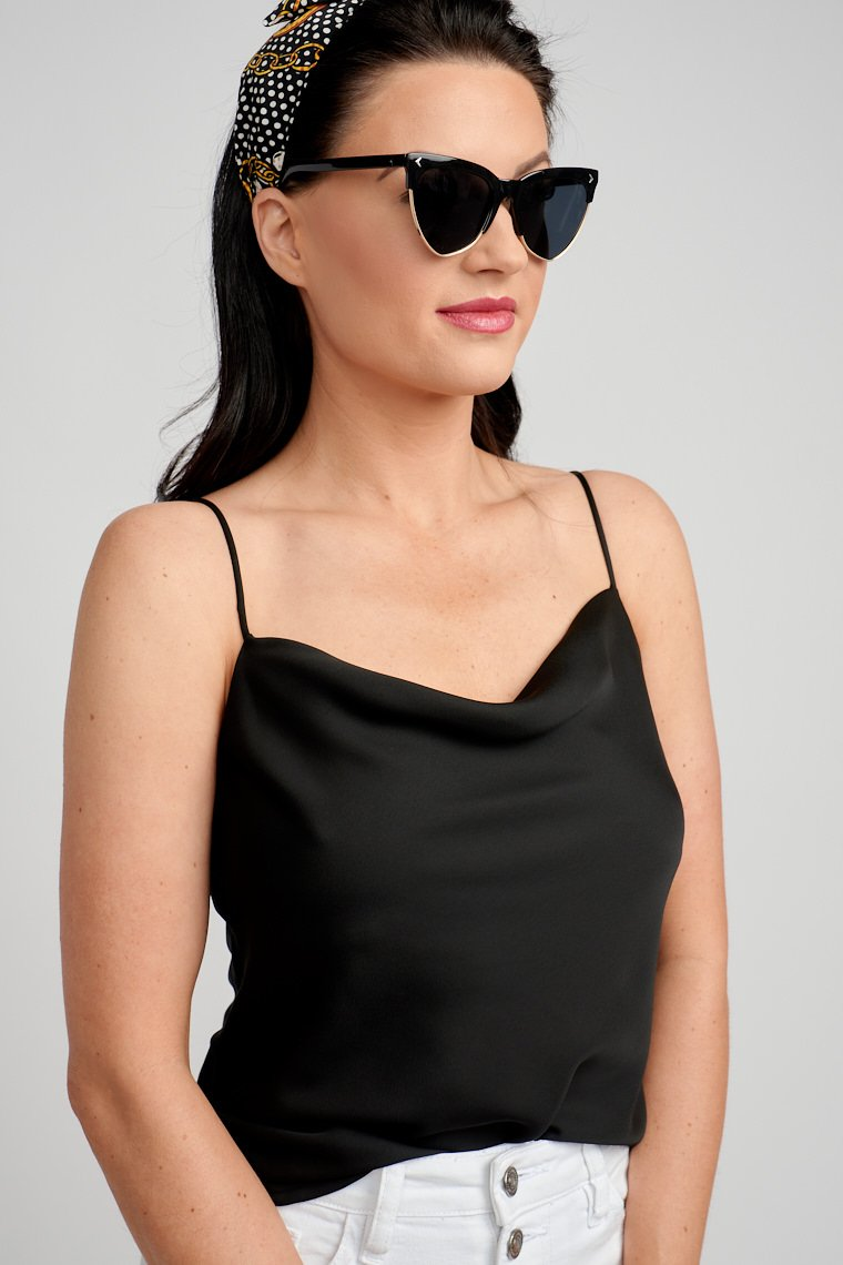 This satiny and lightweight tank top has skinny adjustable straps attached to a cowl neckline that drapes atop the chest and flows into a relaxed bodice.