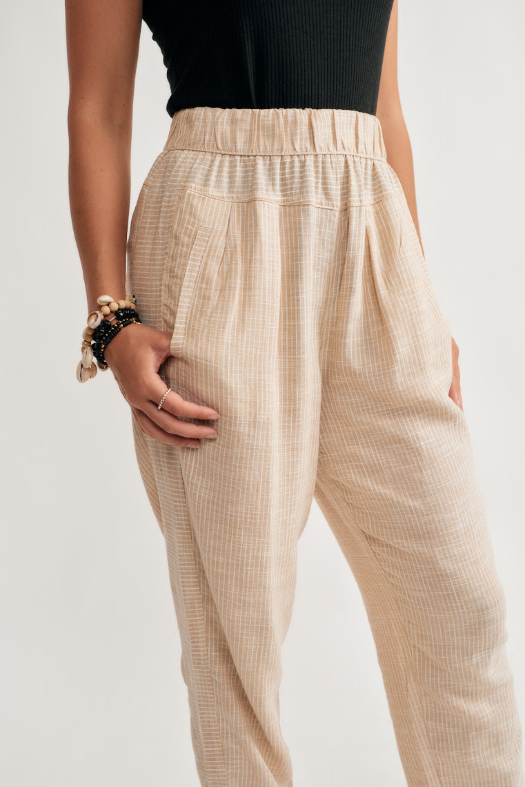These lightweight and breezy pants offer a neutral stripe print on the high-rise fit with an elasticized, banded waist that tapers to an elastic ankle cuff.
