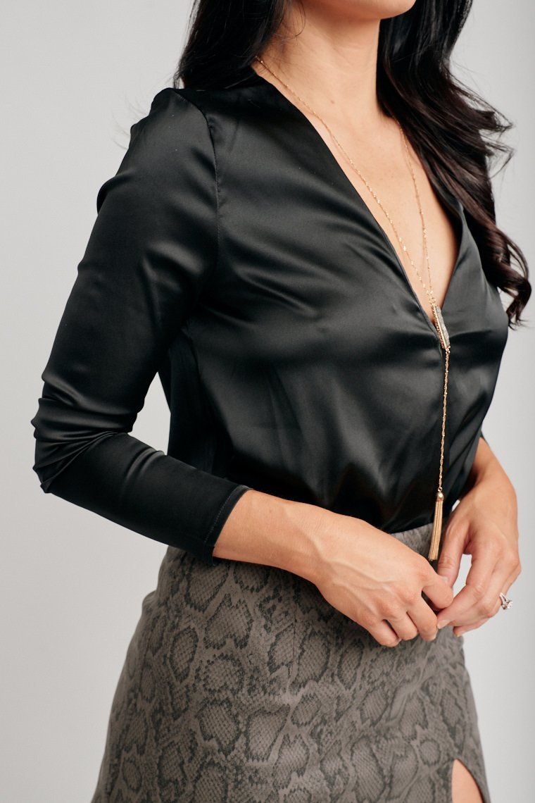 Long sleeves attach to a deep surplice neckline on a comfortable and overside bodice silhouette and lead to briefs This bodysuit features metal closures at the inseam.