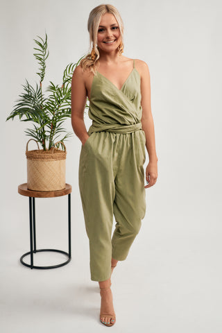 af786b50e04 Lightweight jumpsuit features a surplice neckline