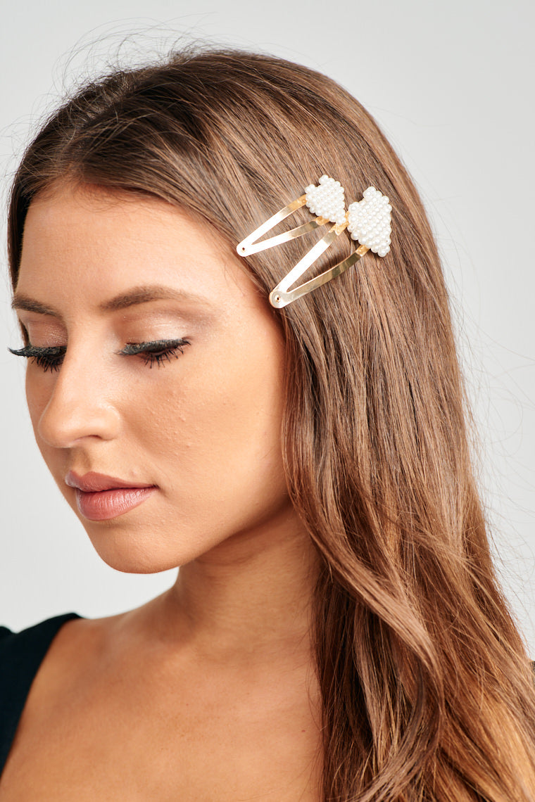 Love your hair but hate the fly-aways? It's alright, girl, just add in the Pearl Hearts of Hair Pins! These will add a sweet touch to your luscious locks this season!