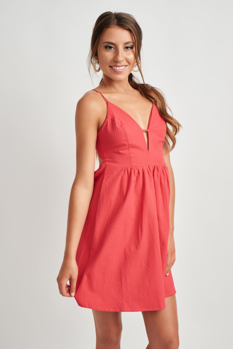 d21c19475f80 This lightweight mini dress with a halter, tie neckline, a plunging, cut-