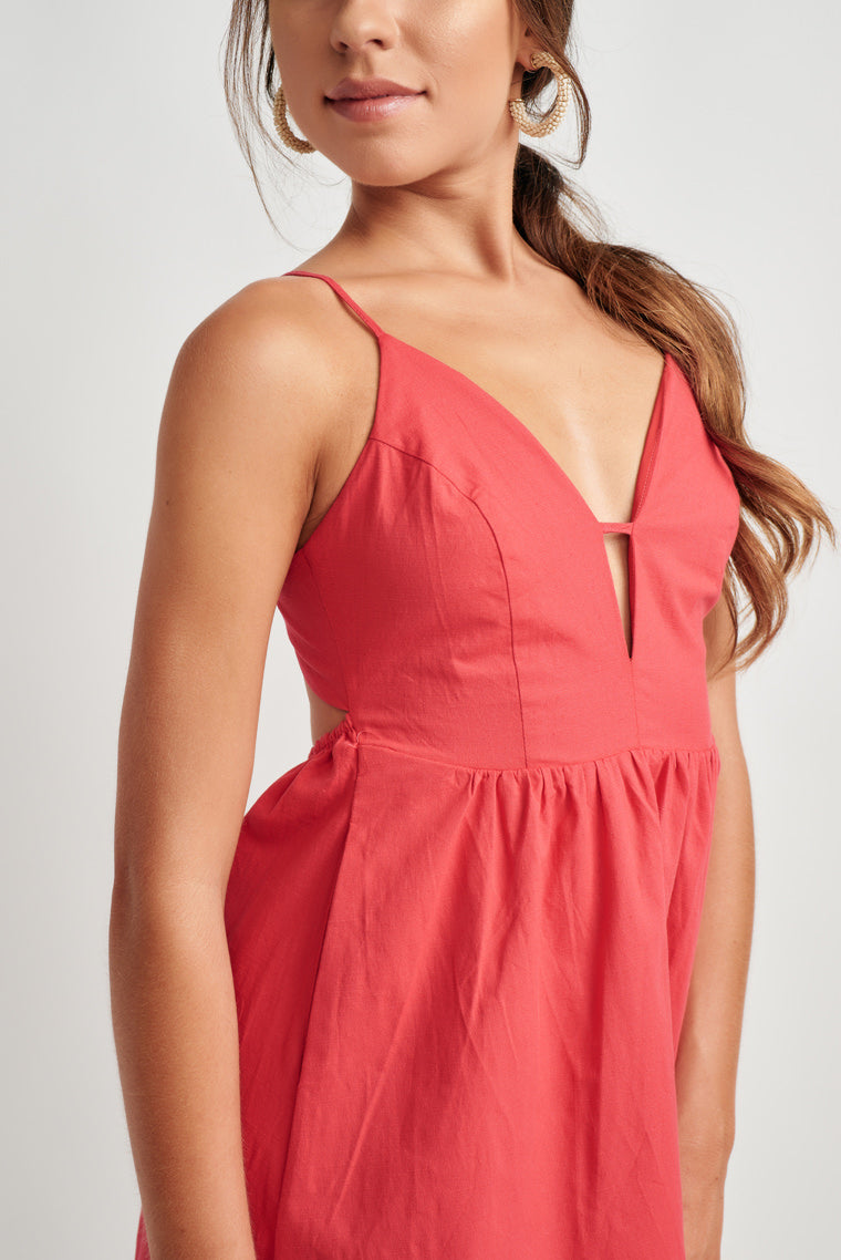 554cc697d213 This lightweight mini dress with a halter, tie neckline, a plunging, cut-.  This lightweight mini dress with a halter, tie neckline, a plunging, cut-