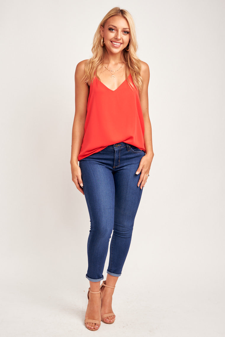 Thin straps attach to a v neckline which leads to a flowy and relaxed bodice. Style by pairing it with jeans and espadrilles for a chic summer look.