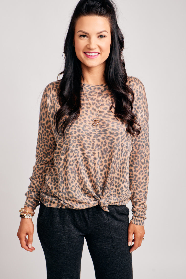This faded leopard print sweater has long cuffed sleeves that attach to a u-neckline with gentle distress details which lead to an oversized and relaxed bodice.