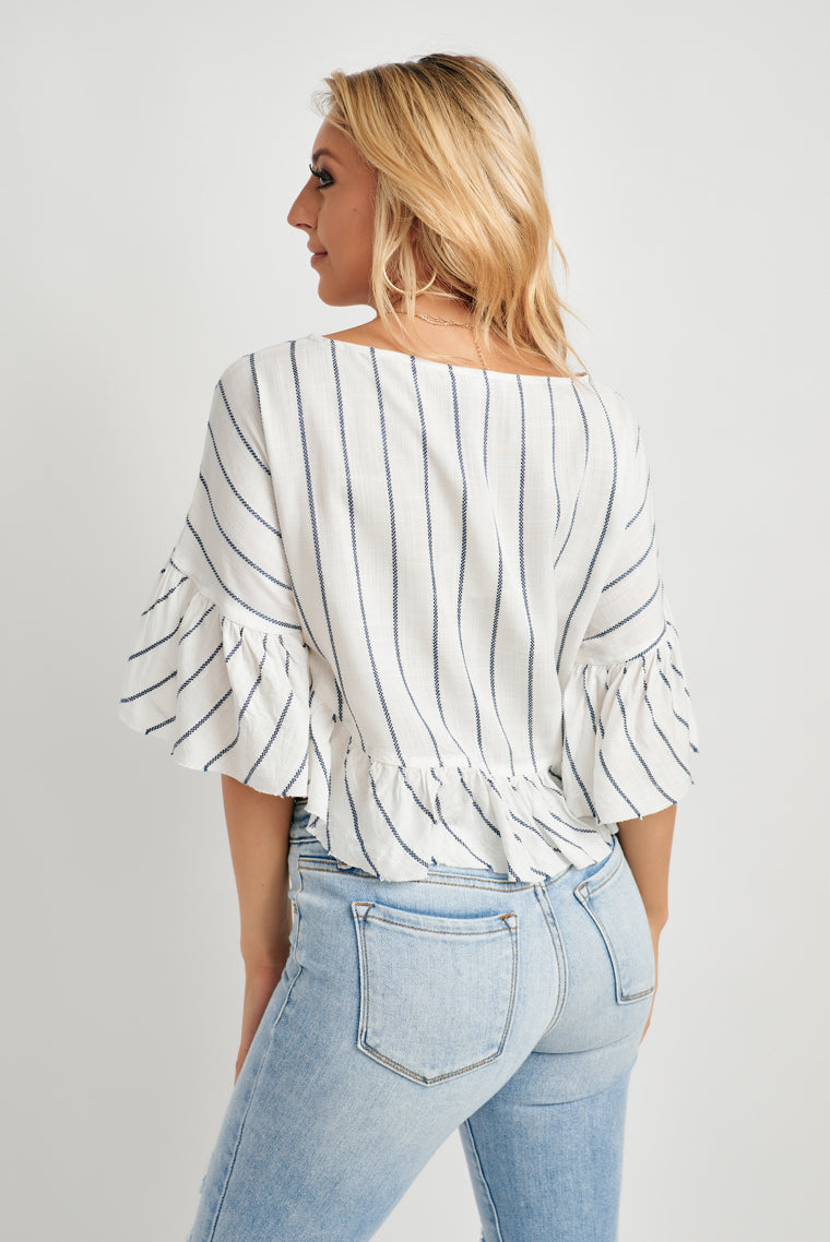 Navy and white stripes shape this crop top with a rounded neckline, oversized, relaxed fit with a tie front feature and ruffled half sleeves.