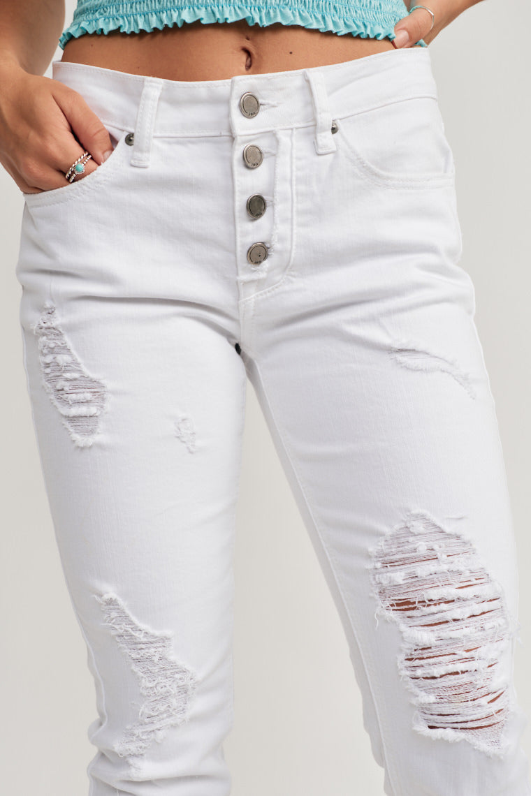 Mid-rise white denim jeans feature a multiple, button up fly with belt loops, a classic five pocket cut and distressing throughout finishing at a cropped hem.