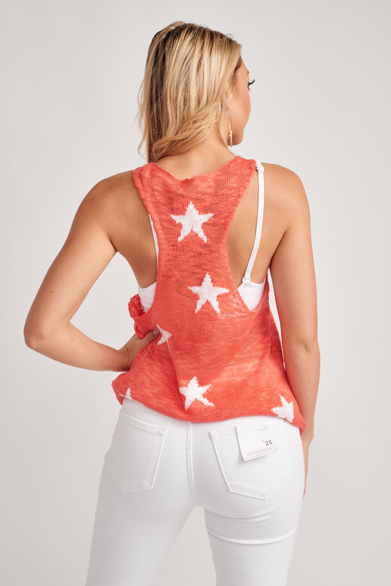 Wear this top with some high-waisted denim! This festive and fun knit tank top offers extremely breathable construction in a red shade with white stars.
