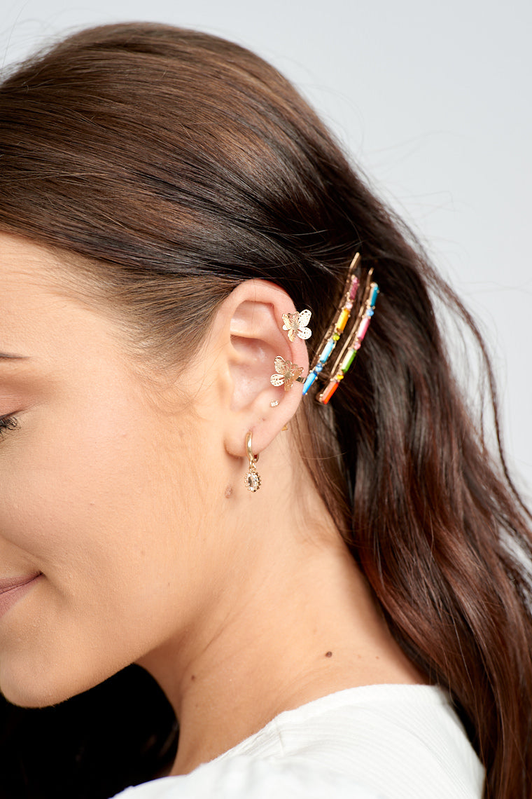 The Selene Butterfly Ear Cuffs and Studs Set will add a fluttery and gold touch to your look with its dainty detailing!
