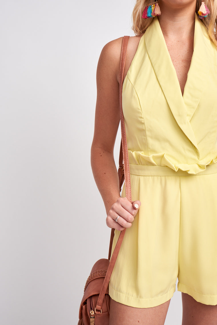 Medium collared straps that lead down to a surplice neckline on a darted and fitted bodice and meets a paper bag style waist on pocketed and pleated relaxed-fit shorts.