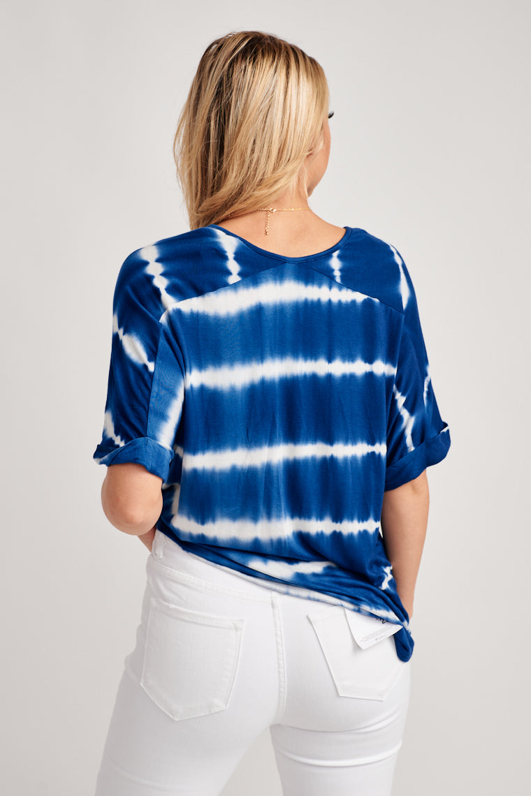 Blue and white tie-dye, lightweight, super comfortable fabric creates a very stretchy, cozy feel to the short sleeve, v-neckline with a tie front feature.