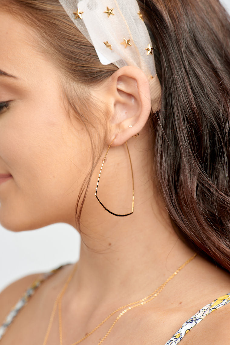 These lightweight earrings have a hoop and post that drops down to a hammer textured wire earring that is an asymmetrically rounded out trapezoid.