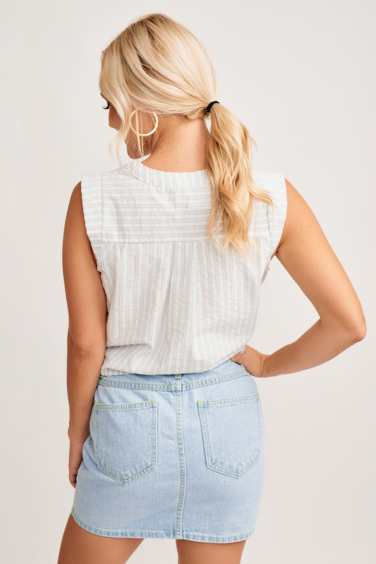 This striped tank has a banded v-slit neckline, horizontal darts at the chest, small capped sleeves and a relaxed button-down bodice that has a tie-front hem.