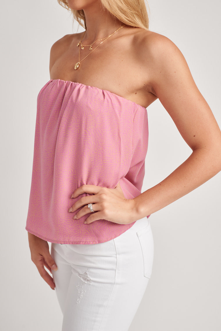 This bubbly pink strapless top is decorated by little yellow dots, with a billowing bodice and relaxed silhouette.