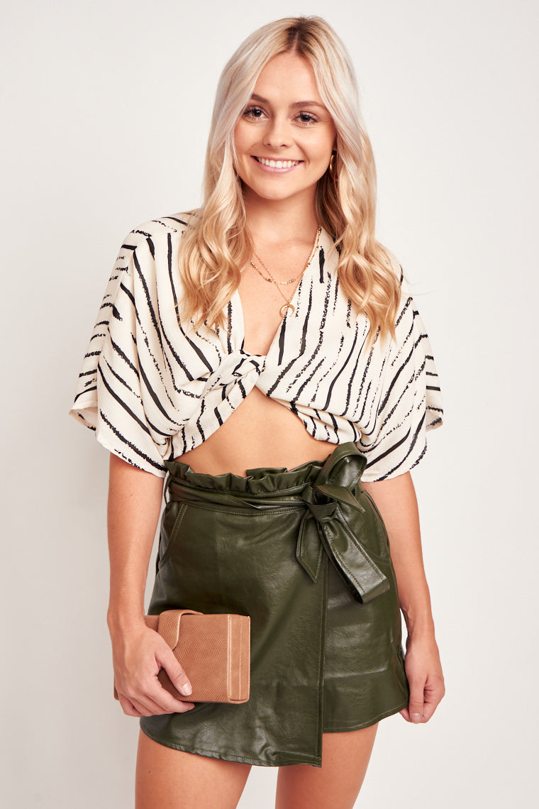 Short sleeve, plunging neckline crop top with tie front hem feature. This top has a comfortable loose bodice that could be tied to fit the bust.