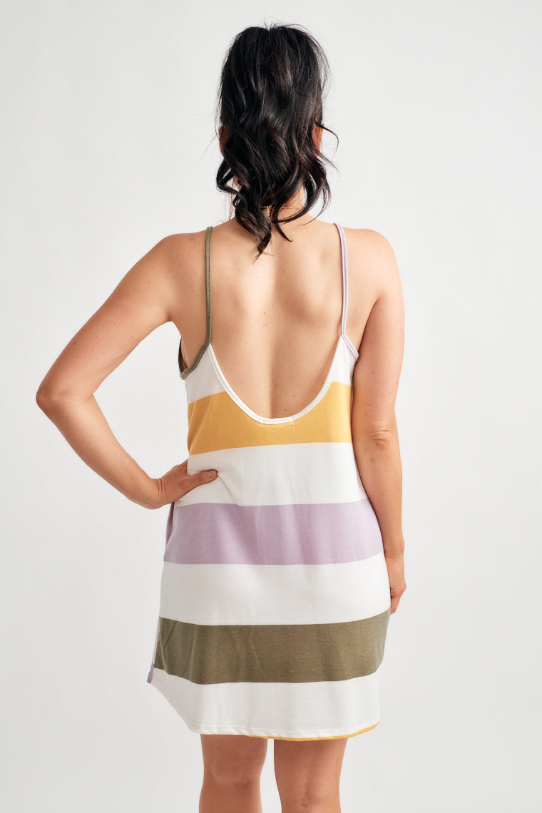 57cf724bf11f Yellow, purples, green and white stripes create this casual and comfortable mini  dress with