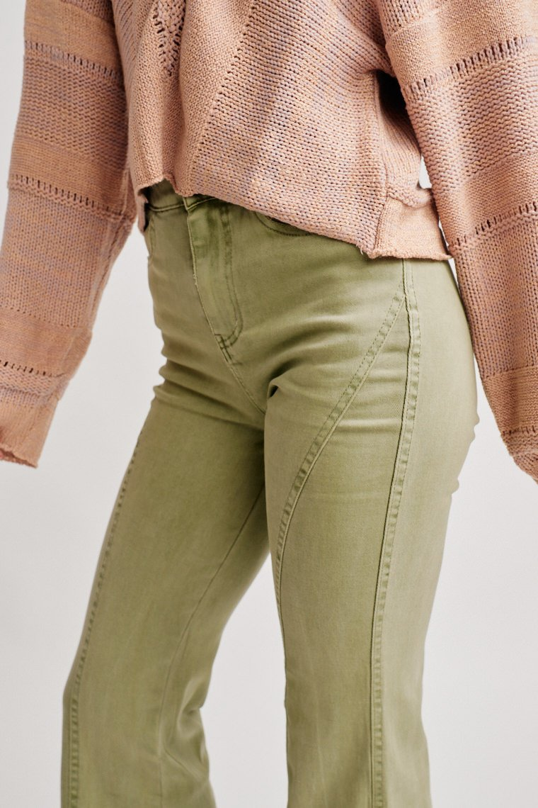 High yoke button and zipper closure at the front and lead to a fitted waist with pockets and lead down to a paneled and middle-striped wide pant leg.
