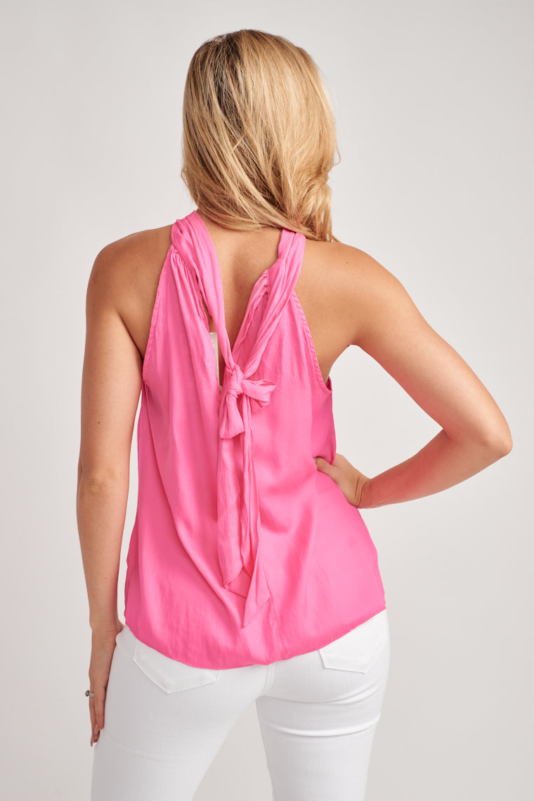 This vibrant, hot pink tank top has high neckline looping through the twist feature and tying to a bow at the back, relaxed bodice and flowy silhouette.
