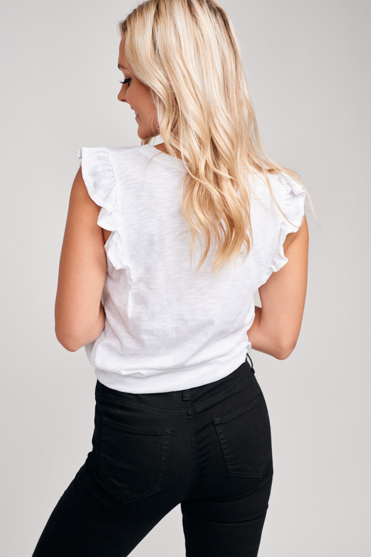 Lightweight fabric makes it an easy style that goes well with a variety of bottoms. This white top has flutter sleeves that attach onto a relaxed bodice with a banded u-neckline.