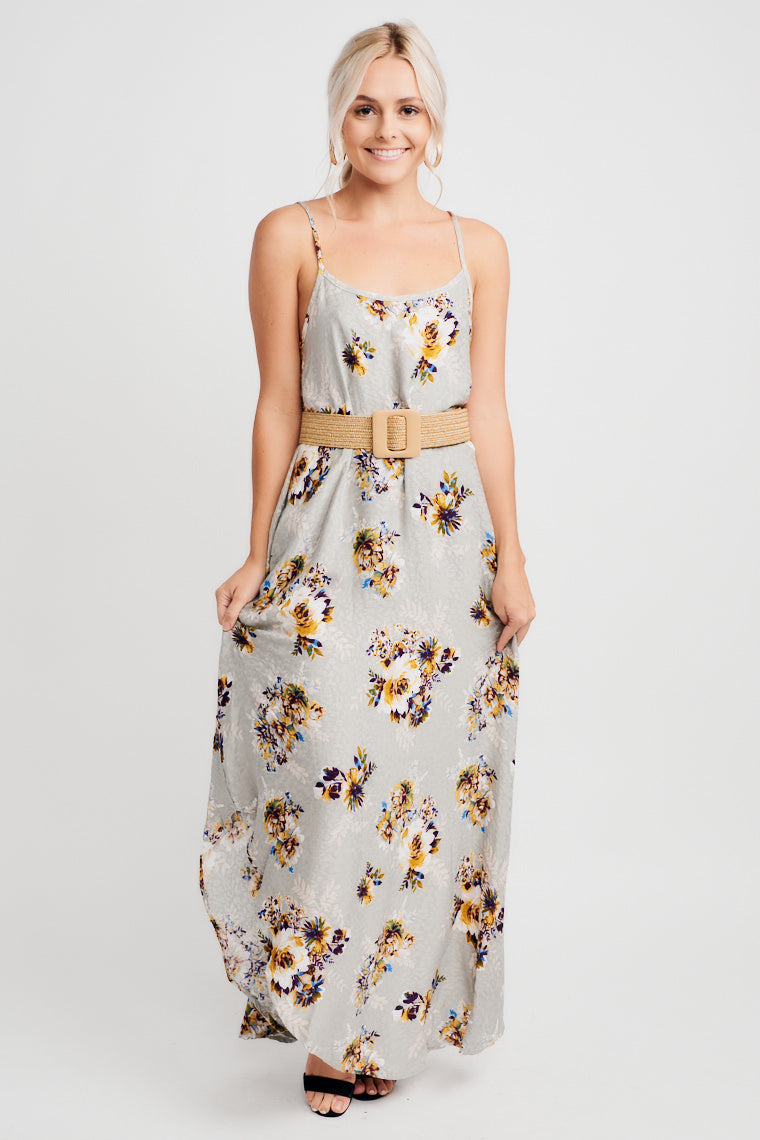 This grey maxi has flowers over faintly raised asymmetrical print. Skinny straps support a rounded neckline on a relaxed bodice and oversized, wide-cut silhouette.