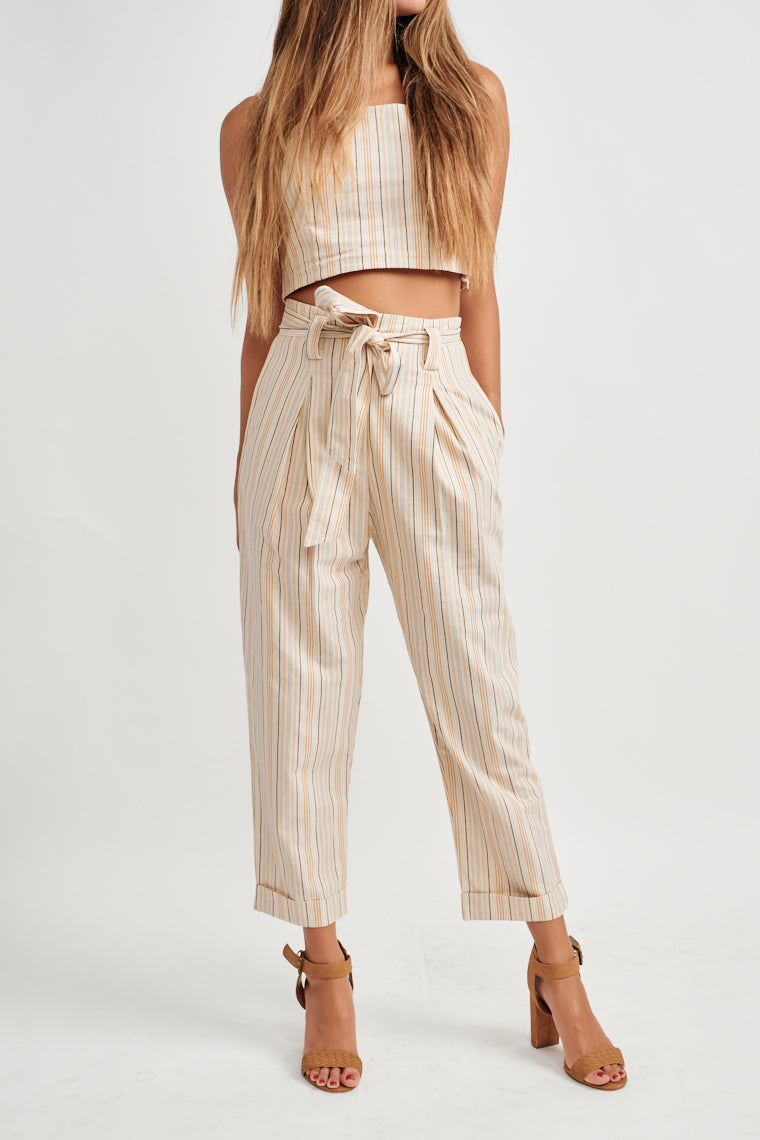 These beige pants are decorated by black, tan and brown stripes, high-rise waistline has a belt feature with a tailored pant leg finishing with a cropped hem.