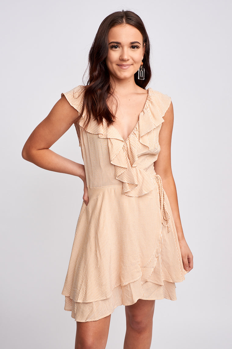 Medium flutter straps that attach to a ruffled surplice neckline on a true-wrap silhouette bodice that ties at the side and skirt with bottom layered hem.