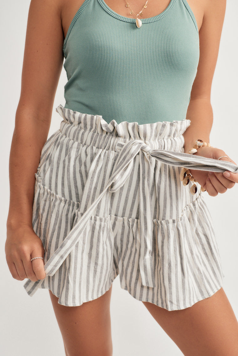 Dusty blue and off white stripes form these summer shorts with a paper bag style waist with a tie feature and a flowy, flare fit.
