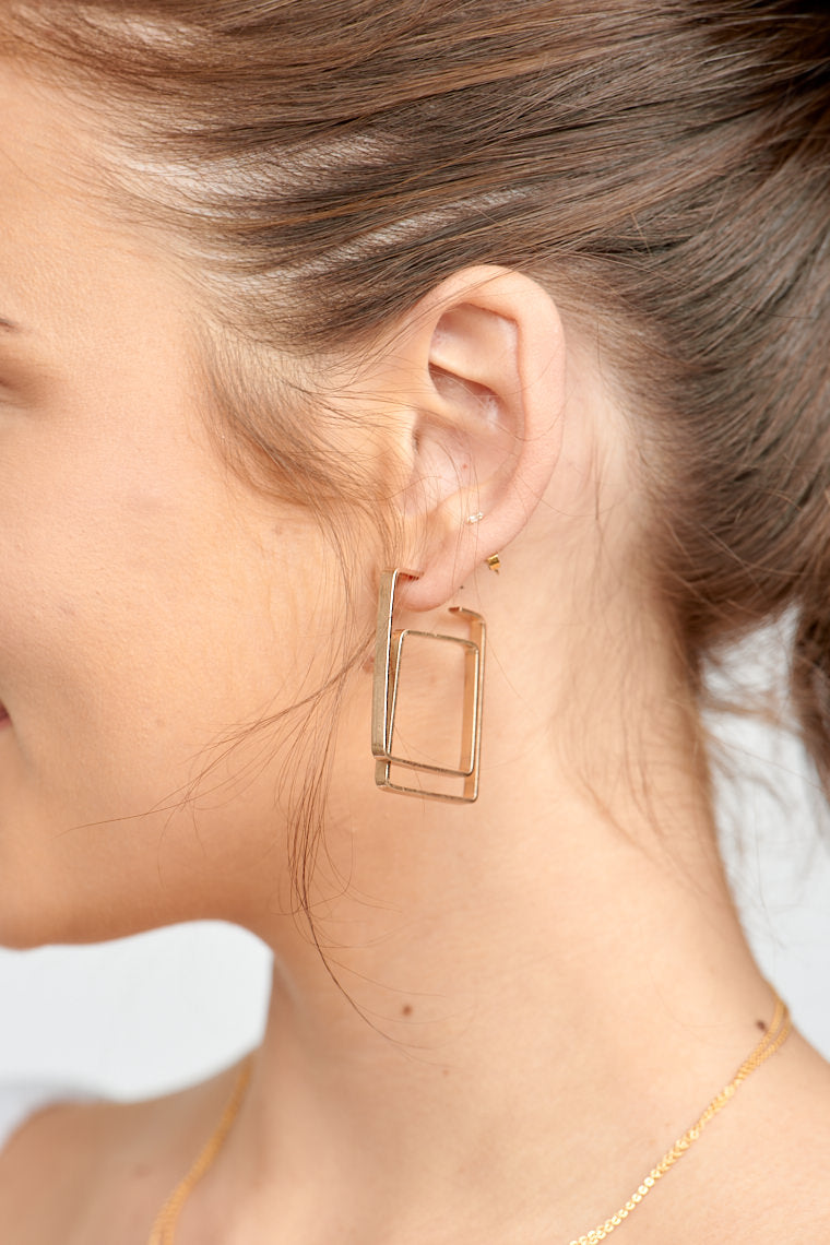 These earrings have a post that attaches to a flat wire and leads to a winding and square shape to add visual interest to any look.