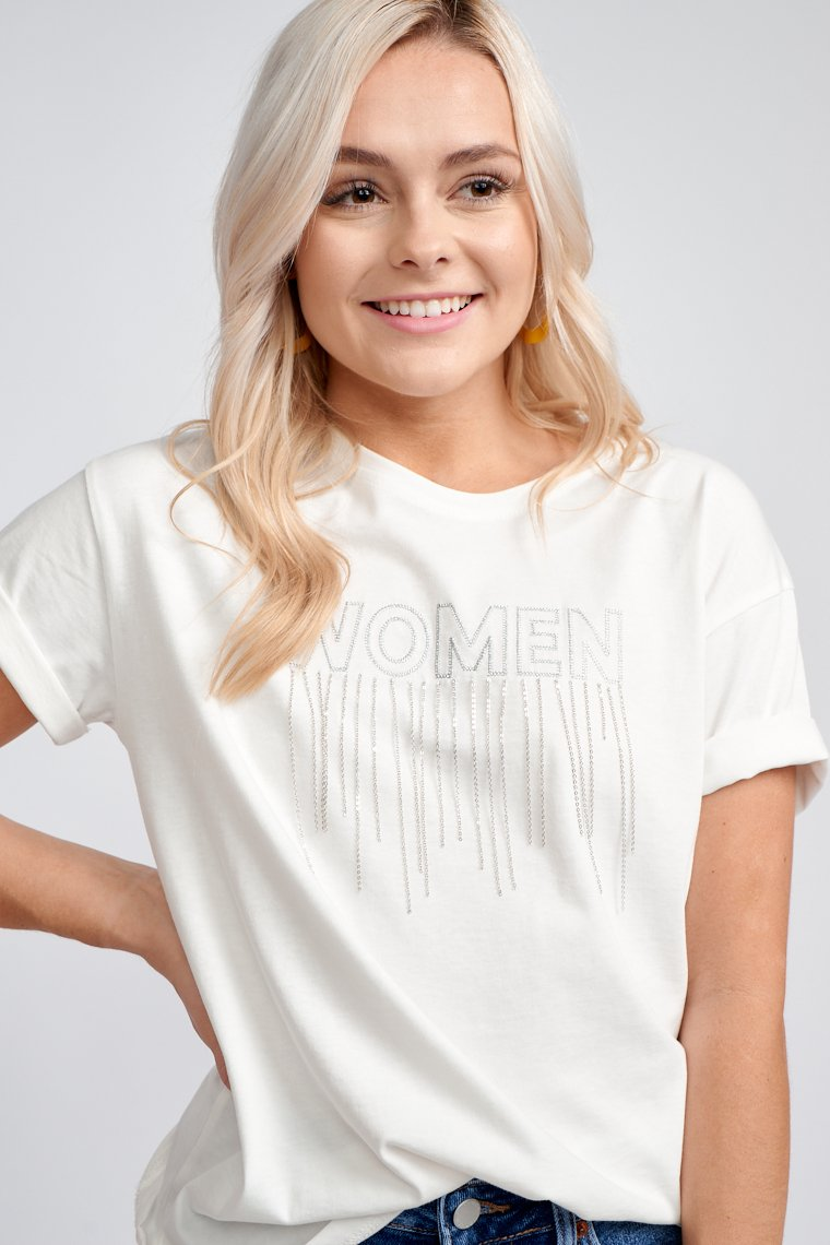 "Short sleeves that attach to a crew neckline and goes into a relaxed bodice. ""Women"" is written in silver across the chest with thin chain tassel drops that cascade underneath."