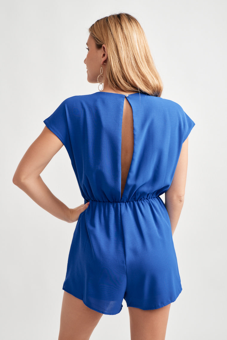 Short sleeve v-neckline with a relaxed bodice with a slit down the back buttoning at the top. The cinched waistline with a tie front feature flows into relaxed shorts.