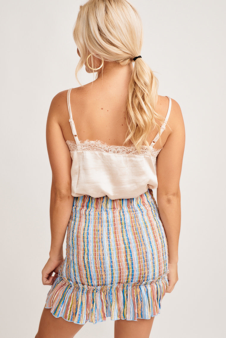 This lightweight tank top has a v-neckline that has a light lace detail across the hem, skinny adjustable straps, and flows into a relaxed bodice.