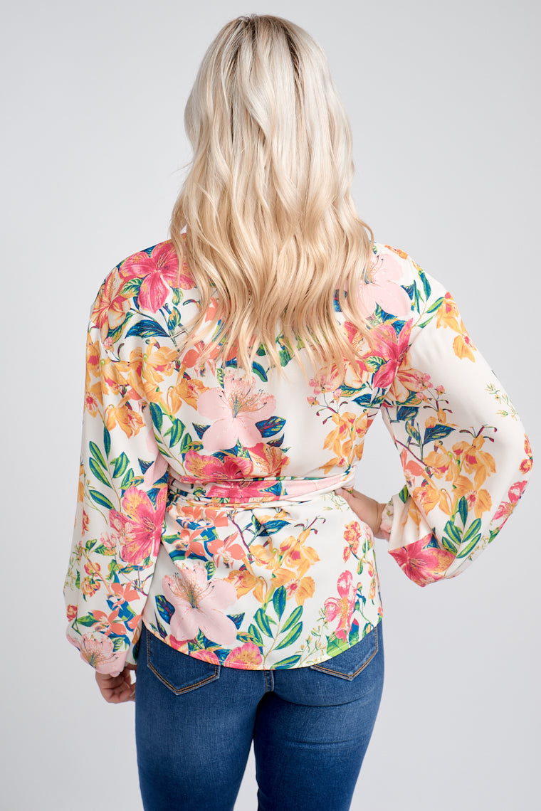 Multicolor floral prints cover the fabric of this lightweight top. Long elastic cuffed sleeves attach to its surplice neckline on a comfortable bodice silhouette.