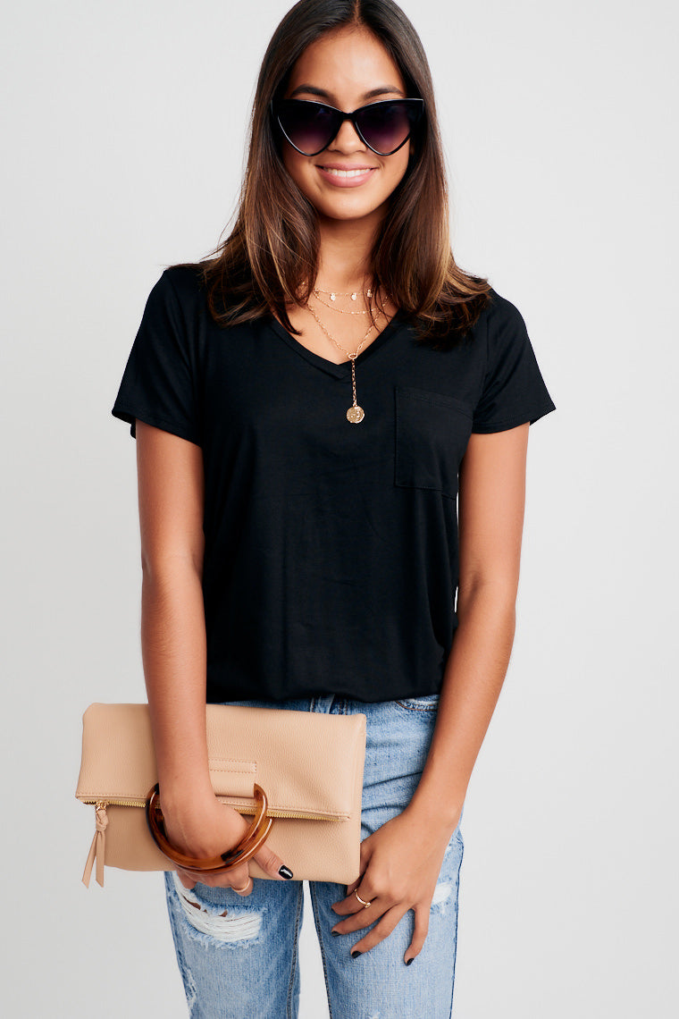 You can't go wrong throwing this tee on! This simple tee has a v-neckline that flows into a relaxed bodice, detailed with a pocket at the chest.