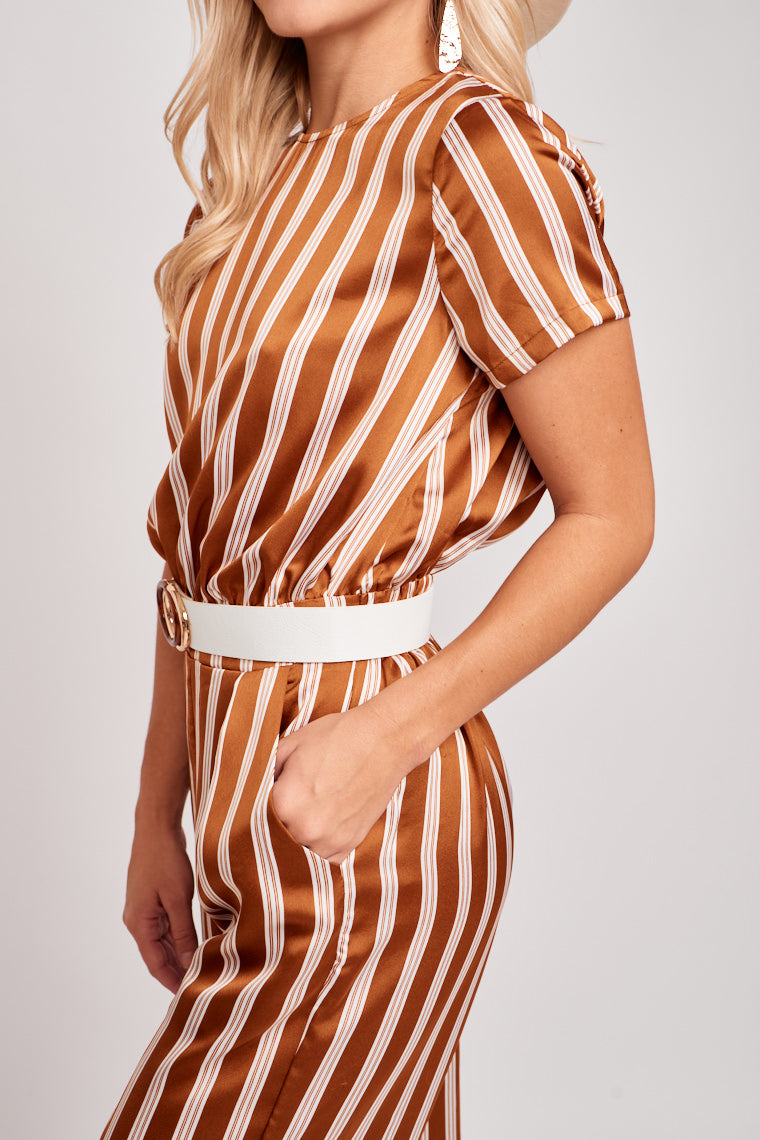 Short sleeves attach to a high u-neckline on a relaxed bodice and lead to an elastic waistband that later flows into relaxed and comfortable pant legs.