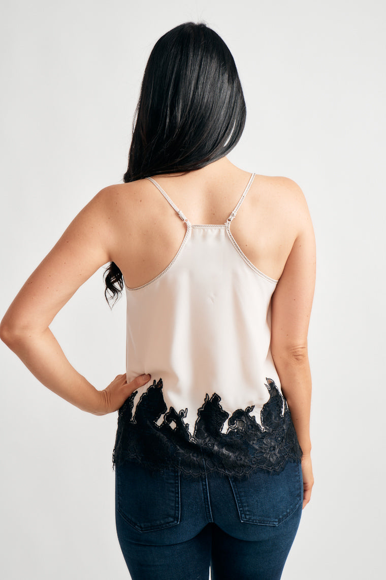 This lightweight tank top offers adjustable skinny straps on a racer back, with a scoop neckline and embroidered lace hem.